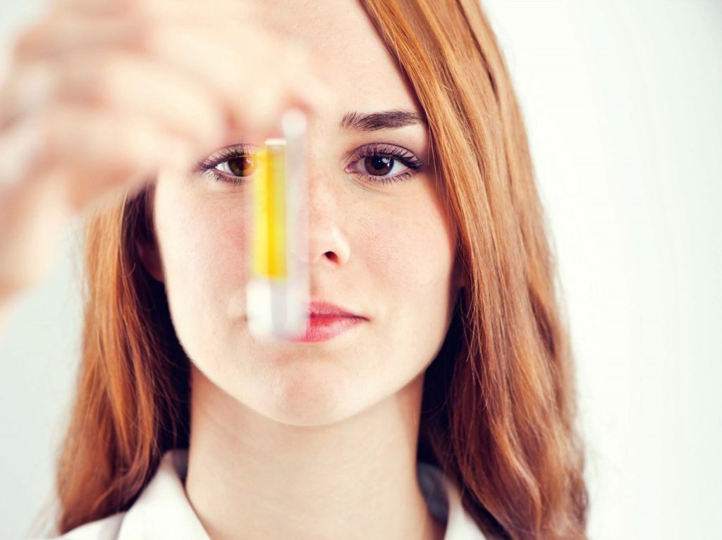 Girl holding serum sample